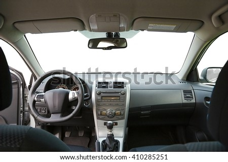 Car interior view of the dashboard from the back - stock photo