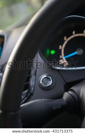 Car interior with turn signal switch (selective focus on signal switch)