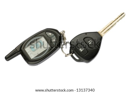 Car key and remote control on the white background
