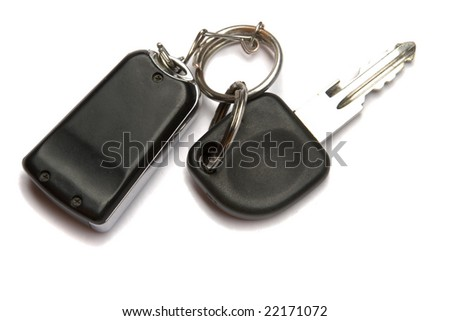 Car key and remote control on white ground - stock photo