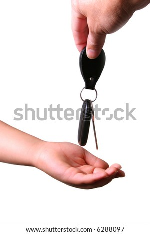 Car Key Hand over to Young Hand - stock photo