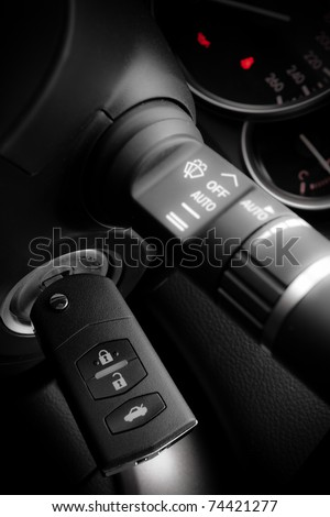 Car key into ignition lock - stock photo