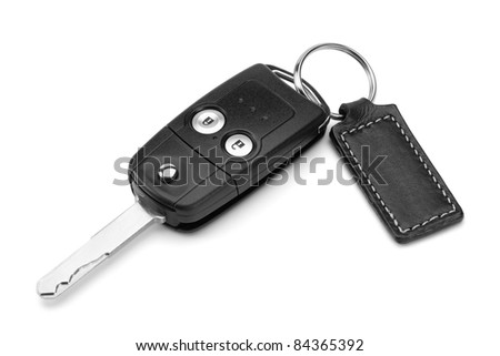 Car key, isolated on the white background, clipping path included. - stock photo