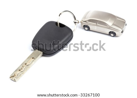Car key isolated on white background with shallow depth of field - stock photo