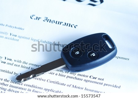 Car key on an insurance policy. Toned.