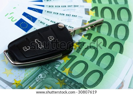 Car key on money background. - stock photo