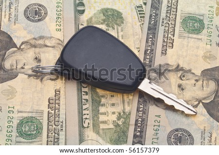 Car Key on Money Background for Financial Automotive Concepts. - stock photo