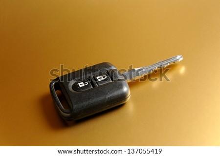 Car key on orange background - stock photo