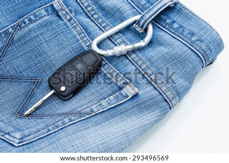 Car key placed on the jeans. - stock photo