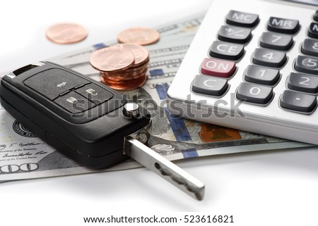 car key with dollars and calculator. US currency