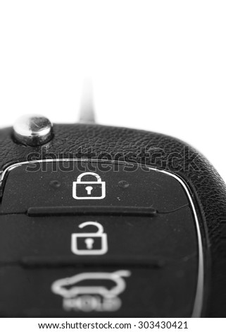 Car key with focus on lock symbol create with multi photo stacking - stock photo