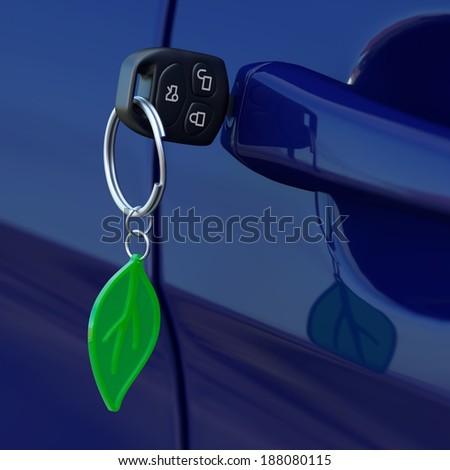 Car key with green leaf key-chain - stock photo