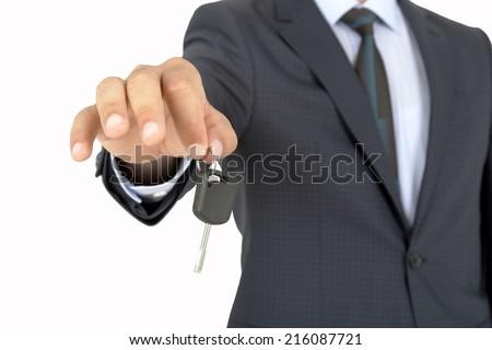 Car Key with human hand - stock photo