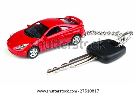 Car key with pendant on white background