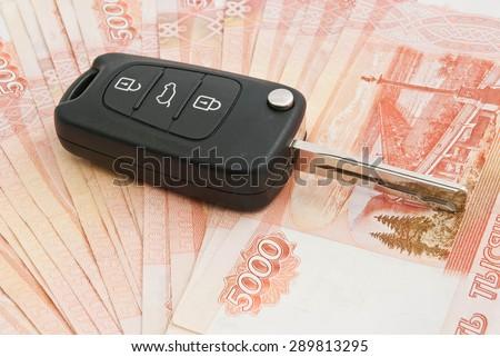 car keys and many Russian rubles notes  - stock photo