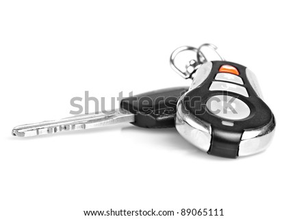 Car keys and remote alarm controller on a white background - stock photo