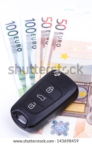 Car Keys and Remote on the money with white background - stock photo