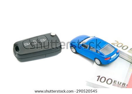 car keys, blue car and euro banknotes on white - stock photo