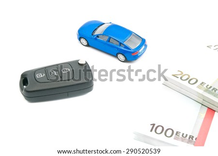 car keys, blue car and euro notes on white - stock photo