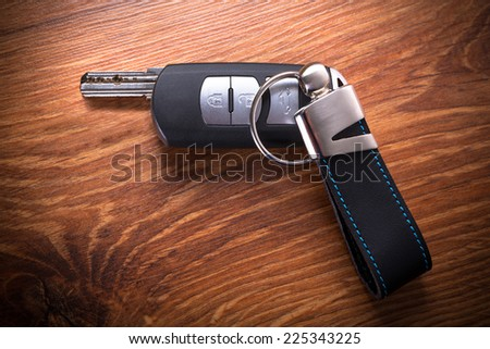 Car keys composing gun shape - stock photo