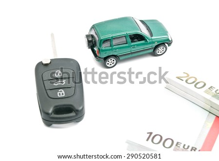 car keys, euro banknotes and green car on white - stock photo