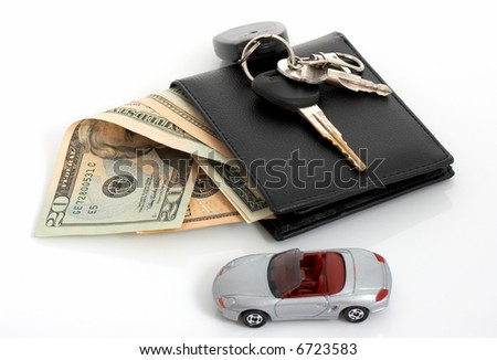 Car keys on a leather wallet with money - stock photo