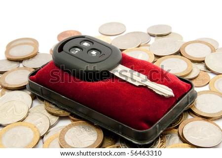 Car keys on a velvet cushion - stock photo