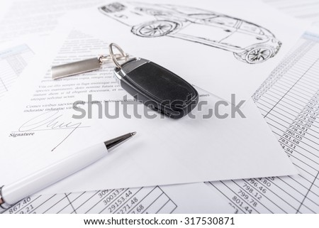 Car keys on the signed agreement document (random latin dummy text used) - stock photo