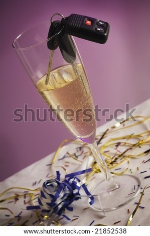 Car keys with champagne - stock photo