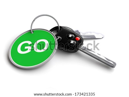 Car keys with keyring of go sign - stock photo