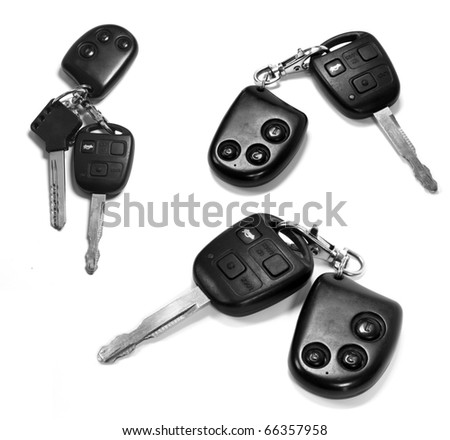 car keys with remotes on white background - stock photo