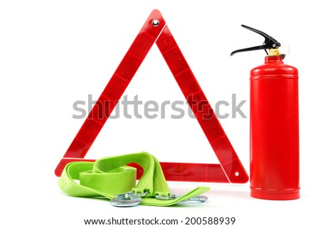 Car kit. Fire extinguisher, emergency sign and tow rope on white background. - stock photo