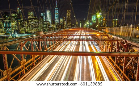Car light on brooklyn bridge in night time, NYC, USA