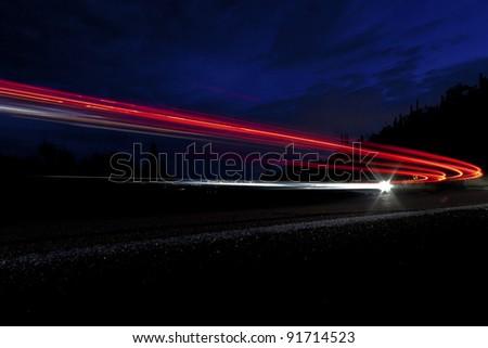 car light on interstate in mountain desert  landscape in Arizona - stock photo