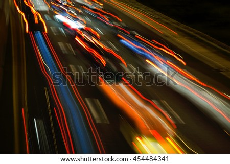 car light streaks moving along a highway at night