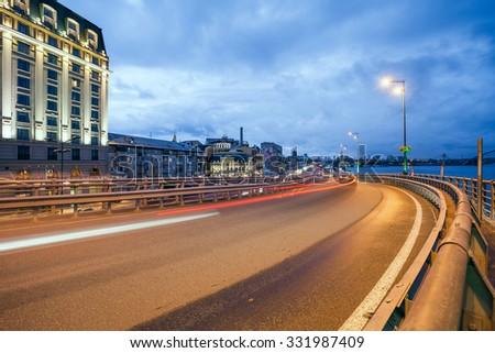 Car light trails and urban landscape. Moving car with blur light through city at night. Kiev city, Ukraine.  - stock photo
