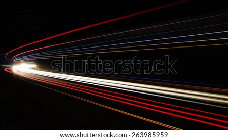 Car light trails in the tunnel. Long exposure photo taken in a tunnel below Veliko Tarnovo - stock photo