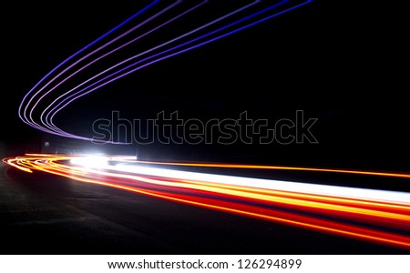 Car light trails in the tunnel. Very art image . Long exposure photo taken in a tunnel - stock photo