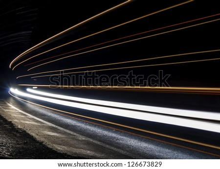Car light trails in the tunnel. Very art image . Long exposure photo taken in a tunnel