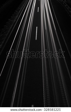 Car light trails, long exposure, top view, black and white - stock photo