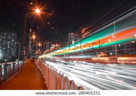 Car light trails on road & fast driving traffic at night