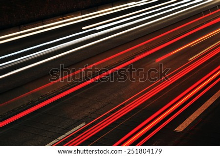 Car light trails on the highway - stock photo