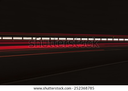 Car light trails on the highway. - stock photo