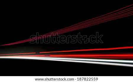 Car light trails on the road - stock photo