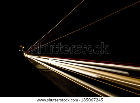 Car light trails on the road, movement of trucks - stock photo