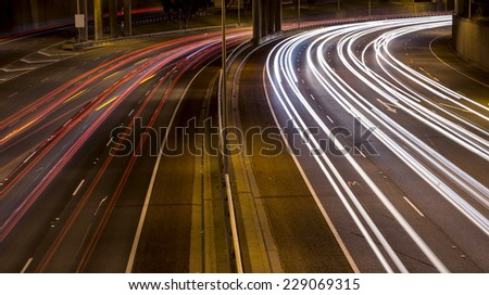 Car lights at night on a freeway, using a long exposure. - stock photo