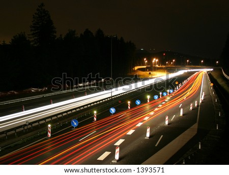 Car lights at night on a highway