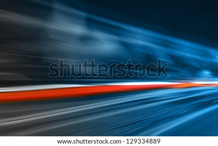 Car lights in motion - stock photo