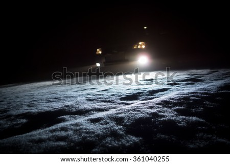 Car lights in winter - stock photo