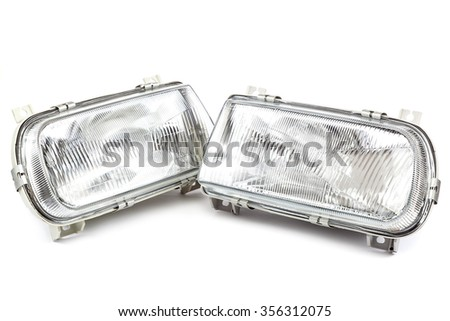 Car lights isolated on white background. - stock photo